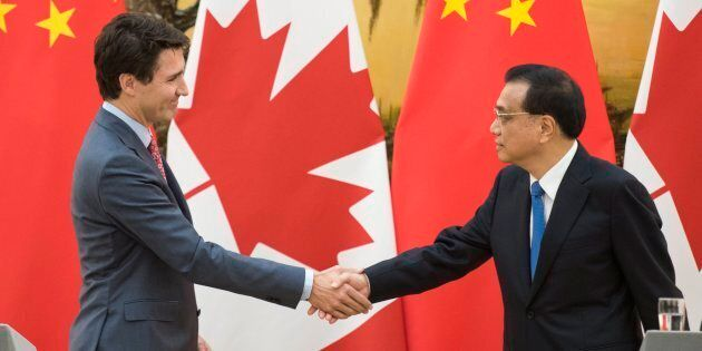 Prime Minister Justin Trudeau shakes hands with Chinese Premier Li Keqiang (right) at a news conference...