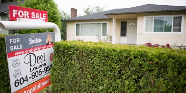 A real estate sign is pictured in Vancouver, B.C., Tues. June, 12, 2018. The Canada Mortgage and Housing...