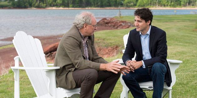 Prime Minister Justin Trudeau chats with Premier Wade MacLauchlan in Cardigan, P.E.I. on June 29,