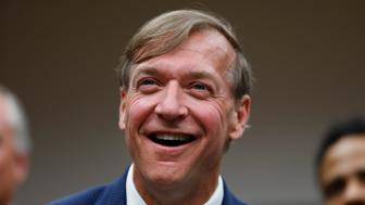 Dr. Samuel Stanley Jr., smiles at a Michigan State University Board of Trustees meeting in East Lansing, Mich., Tuesday, May 28, 2019. Stanley, a medical researcher who has led Stony Brook University in New York for nearly a decade, was named Tuesday as the next president of Michigan State University in the wake of the most extensive sexual abuse scandal in sports history. (AP Photo/Paul Sancya)