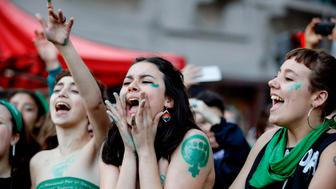 Activists with green handkerchiefs, which symbolizes the abortion rights movement, demonstrate to mark the revival of their campaign to legalize abortion, in front of the National Congress in Buenos Aires, on May 28, 2019. - Activists and lawmakers in Argentina relaunched a bid to legalize abortion on Tuesday with a new bill before Congress and a major demonstration, resuming a battle that has divided the homeland of Pope Francis ahead of October's general election. (Photo by Emiliano Lasalvia / AFP)        (Photo credit should read EMILIANO LASALVIA/AFP/Getty Images)