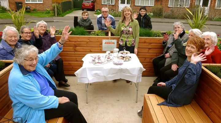 Lyndsey Young (centre, standing up) hosting afternoon tea at The Friendly Bench.