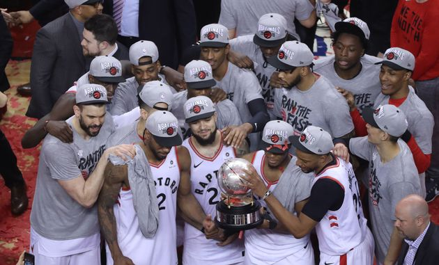 Members of the Toronto Raptors are seen here celebrating their victory over the Milwaukee Bucks in the...