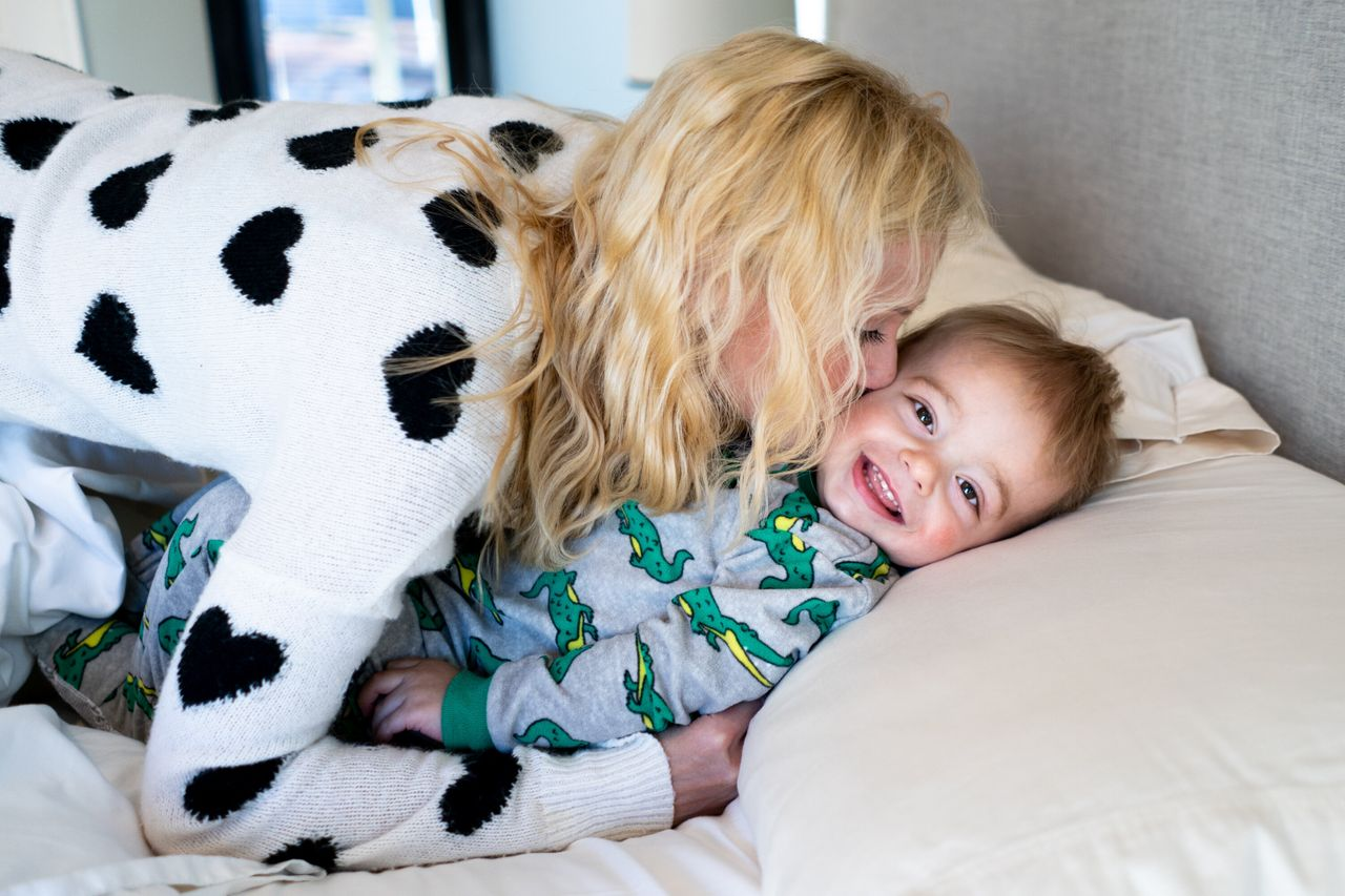 Amber Freed snuggles with her son, Maxwell Freed, 2, as they get ready to start the day at their home in Denver on May 11, 2019.