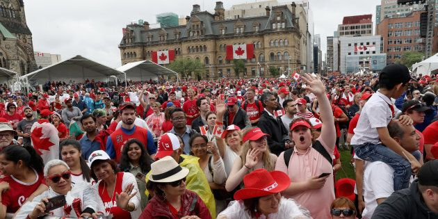 Crowds cheer during during Canada Day celebrations on Parliament Hill on July 1,