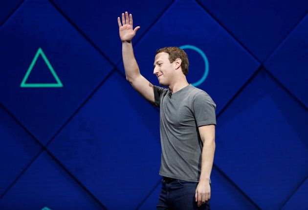 Facebook founder and CEO Mark Zuckerberg waves as he leaves the stage during the annual Facebook F8 developers conference in San Jose, Calif., April 18.