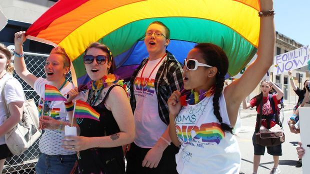 Sandra Curry, left to right, Cassia Tirrell, Nathaniel Curry, and Alizha Gagnon, march Saturday, June 15, 2013 during the annual Pride Parade in Portland, Maine.  (Photo by Joel Page/Portland Press Herald via Getty Images)