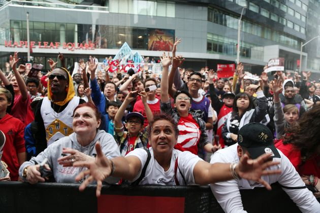 Fans cheer in Jurassic Park as the Raptors play in the Eastern Conference NBA Final in Toronto on May...