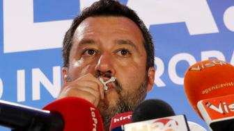 Italian Interior Minister and Deputy Premier Matteo Salvini, of the League, kisses a crucifix as he talks to reporters during a press conference at the League headquarters in Milan, Italy, early Monday morning, May 27, 2019. Italy's anti-migrant, anti-Islam interior minister, Matteo Salvini, boosted his right-wing League party to become the No. 1 party in Italy, with more than 30 percent of the vote, according to early projections. (AP Photo/Antonio Calanni)