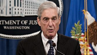 "Robert Mueller, special counsel for the U.S. Department of Justice, speaks at the Department of Justice (DOJ) in Washington, D.C., U.S., on Wednesday, May 29, 2019. Mueller said he found ""insufficient evidence to charge a broader conspiracy"" involving the Trump campaign but didn't reach a conclusion on whether President Donald Trump obstructed justice. Photographer: Andrew Harrer/Bloomberg via Getty Images"
