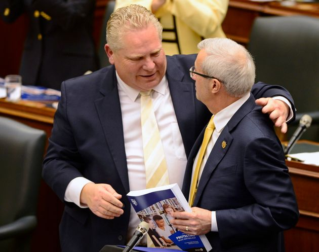 Ontario Finance Minister Vic Fedeli is congratulated by Premier Doug Ford after introducing the budget...