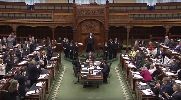 Progressive Conservative MPPs applaud after voting to pass the government's budget bill on May 29,