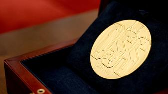 A Congressional Gold Medal is displayed before the start of a ceremony honoring the Office of Strategic Services in Emancipation Hall on Capitol Hill in Washington, Wednesday, March 21, 2018. (AP Photo/Andrew Harnik)