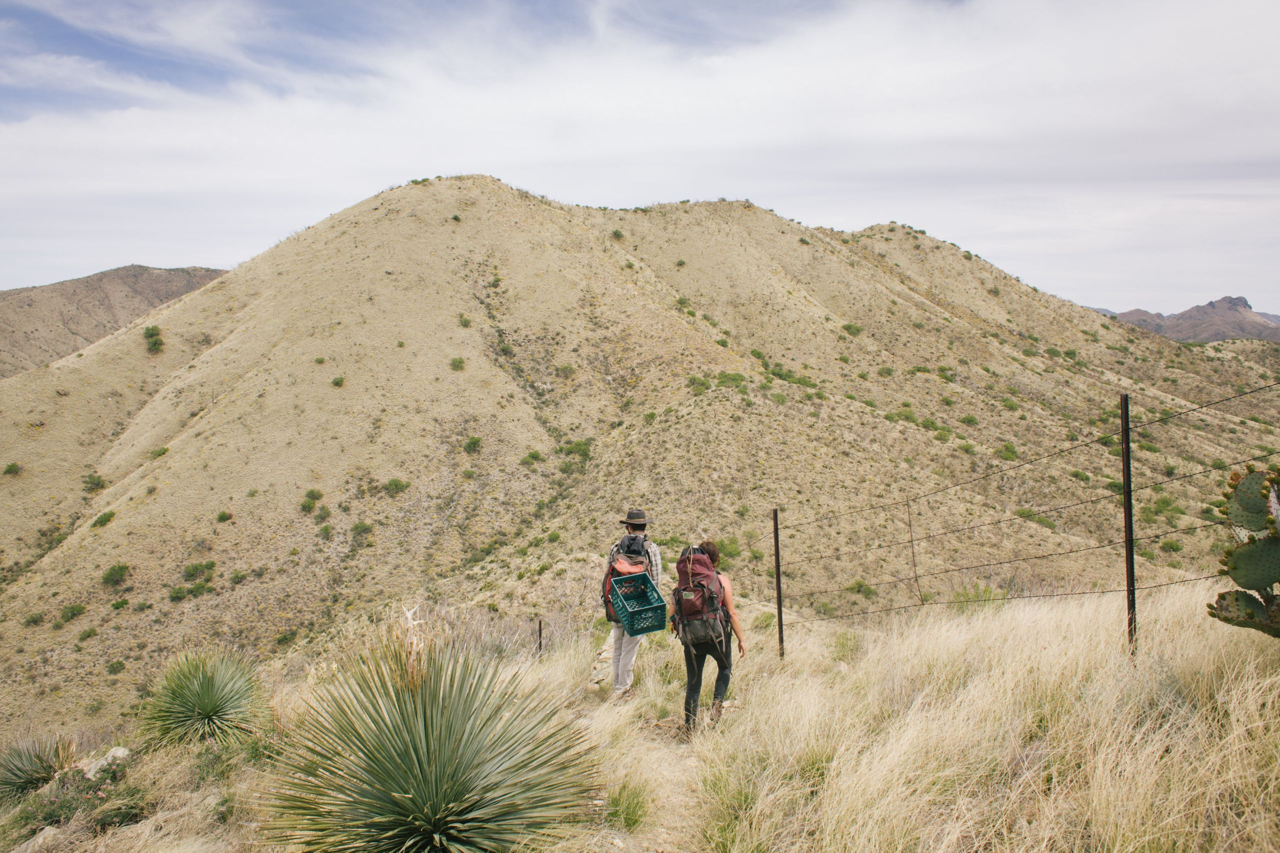 No Más Muertes volunteers Jeff Reinhardt and Esteli Kitchen on a water run in the Altar Valley in Southern Arizona.