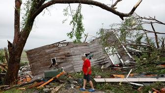 Joe Armison looks over his destroyed barn after a tornado struck the outskirts of Eudora, Kan., Tuesday, May 28, 2019. (AP Photo/Colin E. Braley)