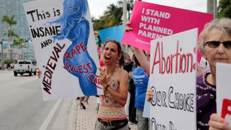 Esperanza Rodriguez, left, shouts during a rally in support of abortion rights, Thursday, May 23, 2019, in Miami. (AP Photo/Lynne Sladky)