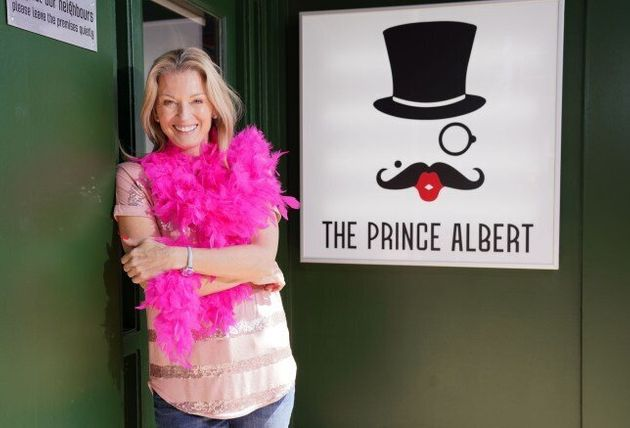 Kathy (Gillian Taylforth) outside her new gay bar, The Prince