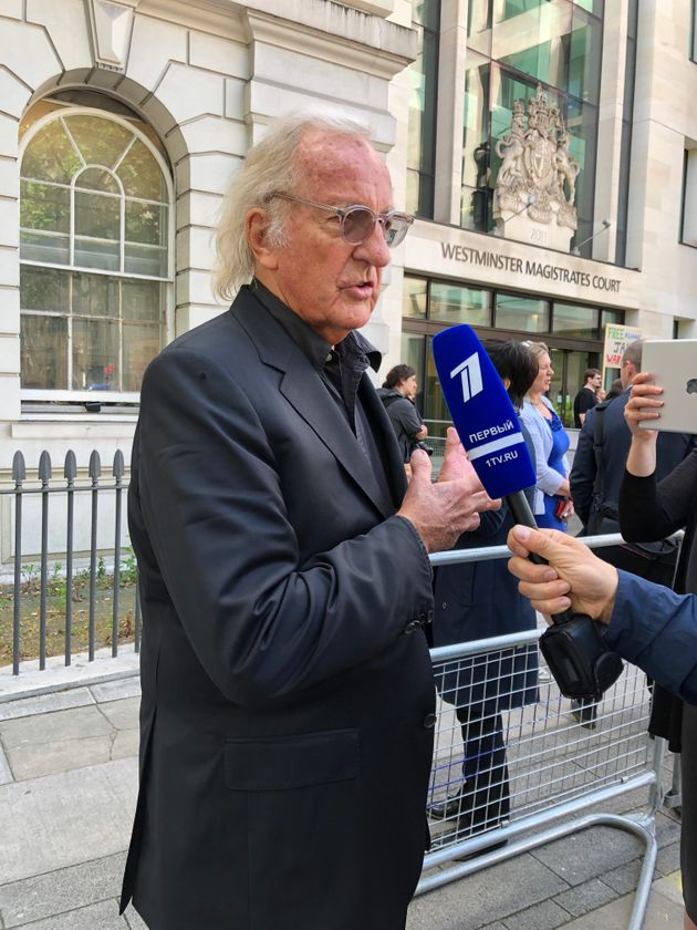 John Pilger outside Westminster Magistrates Court, where he warned that all media organisations are now...