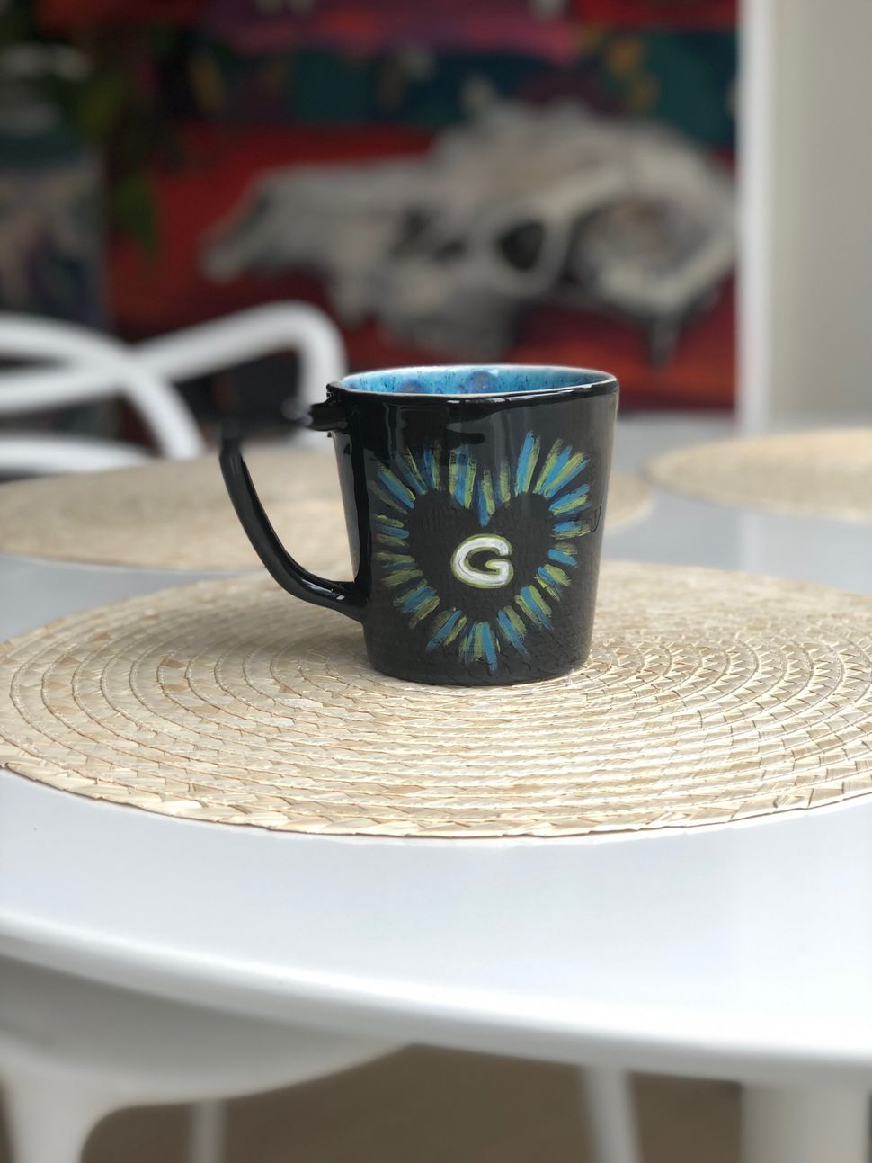 Mark Johnston did not want his photo published, but was proud of this mug he painted for Jessyca Greenwood...