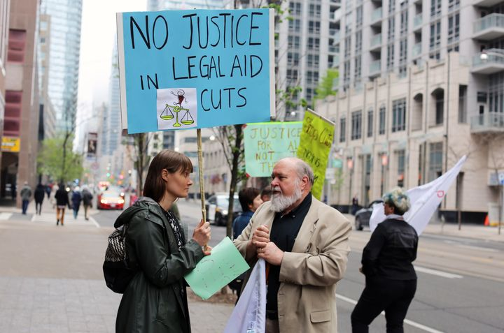 Dana Fisher, a legal aid union representative, outside of the Ministry of Attorney General's office in May protesting the cuts to legal aid. She was joined by other Society of United Professionals members, including President Scott Travers (right).