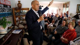 Democratic presidential candidate Sen. Cory Booker, D-N.J., speaks during a house party, Friday, May 24, 2019, in Newton, Iowa. (AP Photo/Charlie Neibergall)