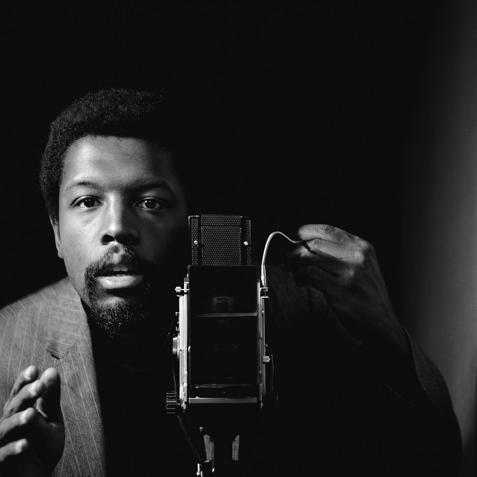 "Kwame Brathwaite, Self-portrait, African Jazz-Art Society & Studios (AJASS), Harlem, circa 1964. From ""Kwame Brathwaite: Black Is Beautiful"" (Aperture, 2019)."