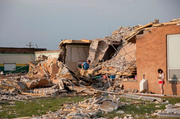 Damage at a school in Dayton, Ohio, is surveyed on Tuesday, after powerful tornadoes ripped through the area and caused at le