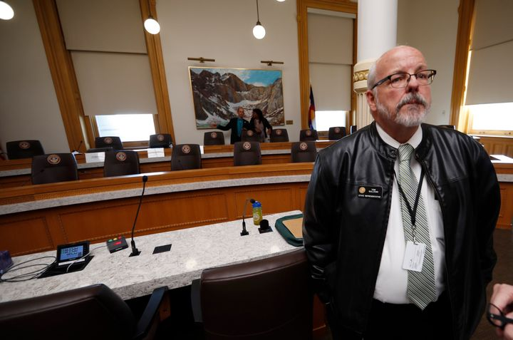 Wearing his son's leather jacket, Colorado Rep. Tom Sullivan waits to speak during a hearing before the House Judiciary Commi