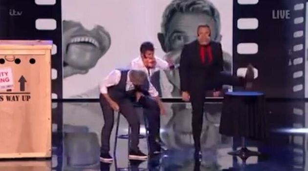 Simon stormed off stage after Jimmy grabbed at his
