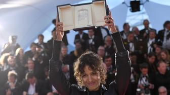 "CANNES, FRANCE - MAY 25: Mati Diop, winner of the Grand Prix Award for the film ""Atlantique"", poses at the winner photocall during the 72nd annual Cannes Film Festival on May 25, 2019 in Cannes, France. (Photo by Stephane Cardinale - Corbis/Corbis via Getty Images)"