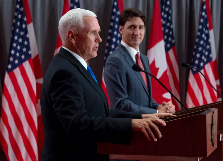 Prime Minister Justin Trudeau listens as U.S. Vice-President Mike Pence makes his opening statement during a joint news conference in Ottawa on May 30, 2019.