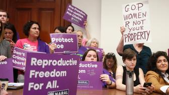 "Supporters crowd a meeting room before a roundtable discussion at the Georgia State Capitol in Atlanta on Thursday, May 16, 2019 to discuss abortion bans in Georgia and across the country. Georgia was the fourth state this year to pass anti-abortion ""heartbeat"" legislation, but Democratic presidential candidates have taken aim at the state's law banning most abortions after six weeks that's set to go into effect in January. (Bob Andres/Atlanta Journal-Constitution via AP)"