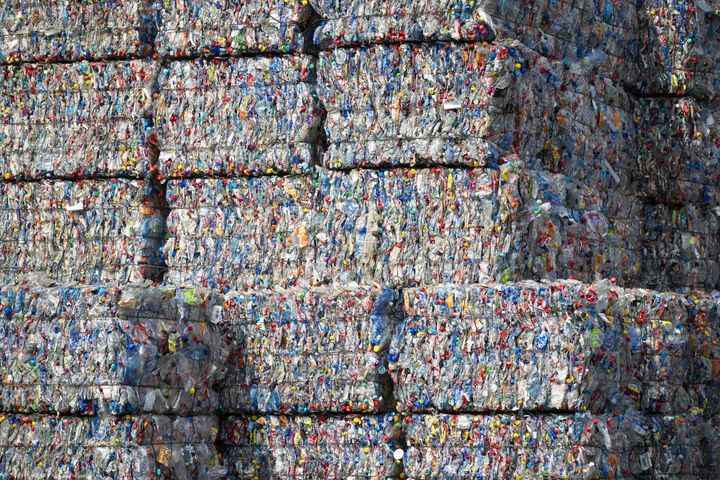 Sorting facilities like TotalRecycle crush plastics together into bales so they can be transported.