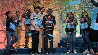 The co-champions of the 2019 Scripps National Spelling Bee, from left, Sohum Sukhatankar, 13, of Dallas, Texas, Abhijay Kodali, 12, of Flower Mound, Texas, Rohan Raja, 13, of Irving, Texas, Saketh Sundar, 13, of Clarksville, Md., Christopher Serrao, 13, of Whitehouse Station, N.J., Rishik Gandhasri, 13, of San Jose, Calif., Erin Howard, 14, of Huntsville, Ala., and Shruthika Padhy, 13, of Cherry Hill, N.J., celebrate in Oxon Hill, Md., Friday, May 31, 2019. (AP Photo/Susan Walsh)