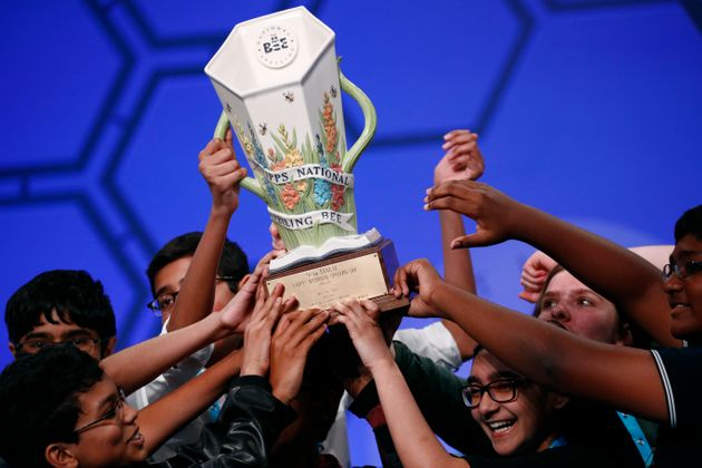 Eight co-champions celebrate after winning the Scripps National Spelling