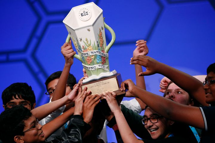 Eight co-champions celebrate after winning the Scripps National Spelling Bee.