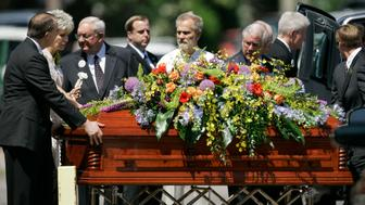 Mrs. George Tiller, second from left, follows the casket of her husband out of College Hill United Methodist Church in Wichita, Kan., Saturday, June 6, 2009. Tiller, 67, a late-term abortion provider, was shot in the head Sunday as he handed out programs while ushering at Reformation Lutheran Church in Wichita. Scott Roeder, a 51-year-old abortion opponent, was arrested a few hours later just outside Kansas City. (AP Photo/Orlin Wagner)