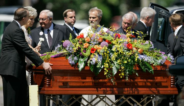 Mrs. George Tiller, second from left, follows the casket of her husband out of College Hill United Methodist Church in Wichit