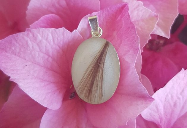 This piece by Victoria jewelry designerSandra McMullen contains a mom's breast milk and some hair...