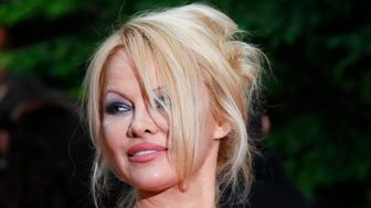 US actress Pamela Anderson arrives with Soccer player Adil Rami at the UNFP (Union of French Professional Footballers) ceremony, in Paris, France, Sunday, May 19, 2019. (AP Photo/Francois Mori)