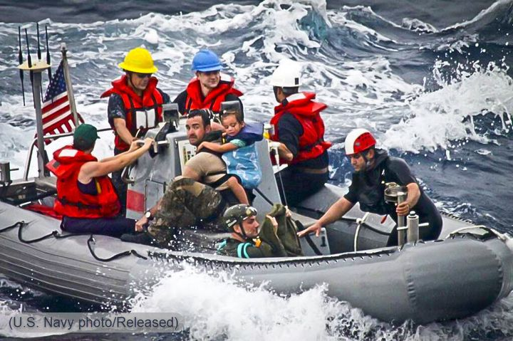 In a rescue boat with pararescuemen from the 131st Rescue Squadron of the California Air National Guard and sailors from the
