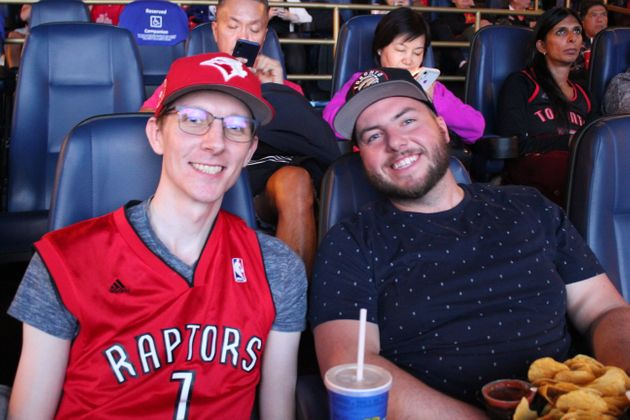 Raptors fans Michael and Cody take in the action of Game 1 of the NBA Finals from a downtown Vancouver...