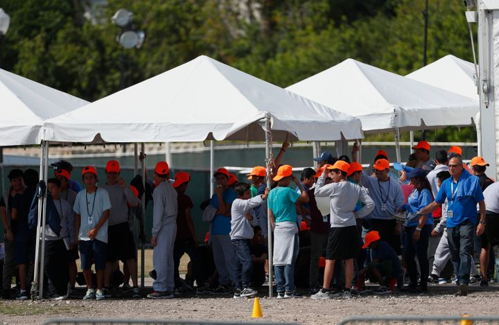 Migrant children stand outside the Homestead Temporary Shelter for Unaccompanied Children in Homestead, Florida, on May 6, 20