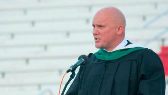In this May 23, 2019 photo, Principal Kenny DeMoss gives closing remarks during Parkersburg High School's 2019 graduation ceremony, in Parkersburg, W.Va. The West Virginia principal accused of plagiarizing Ashton Kutcher in the address to his school's graduating class says he didn't mean to use someone else's work. DeMoss has issued a statement saying he should have cited his sources in the speech, but asserted the ideas were his own. (Michael Erb/News and Sentinel via AP)
