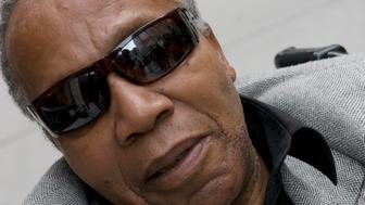 "FILE - This Nov. 2, 2007 file photo shows Frank Lucas, the man Denzel Washington portrayed in the film ""American Gangster,"" in New York. The Harlem drug kingpin whose life became the basis for the 2007 movie ""American Gangster"" has died. Frank Lucas was 88. His nephew Aldwan Lassiter confirms Lucas died Thursday, May 30, 2019 in New Jersey, where he had lived for years.  (AP Photo/Jim Cooper, File)"