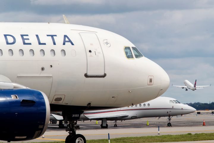 An employee in Delta's operations control center sent a directive to a Delta gate agent directing them not to open the