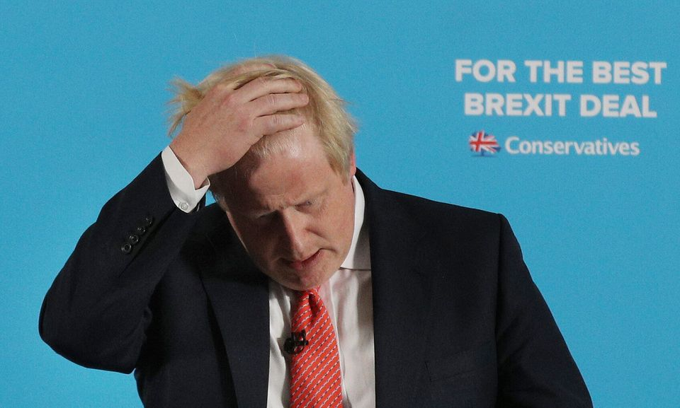 Boris Johnson in classic 'hair-ruffling'