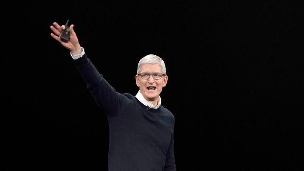 Apple CEO Tim Cook waves while walking on stage at the Steve Jobs Theater after an event to announce new products Monday, March. 25, 2019, in Cupertino, Calif. (AP Photo/Tony Avelar)