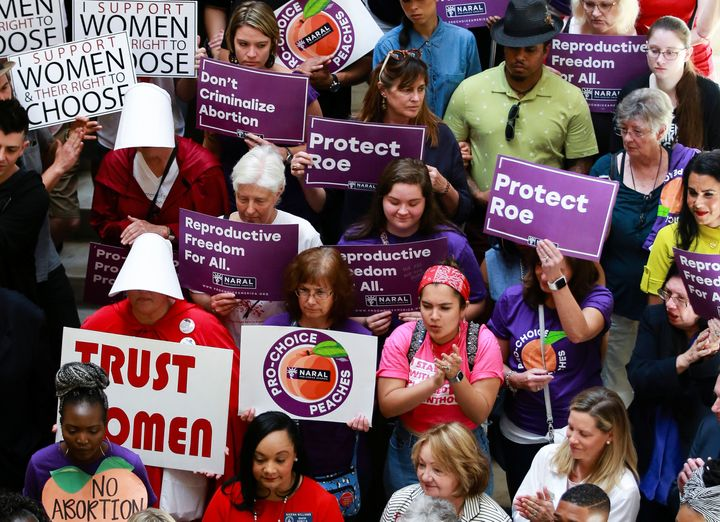 Activists and politicians in Atlanta protest Georgia's strict anti-abortion law that was signed by the governor last month.