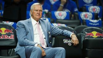 Jerry West sits on the bench before an NBA basketball game between the Los Angeles Clippers and the Phoenix Suns Saturday, Oct. 21, 2017, in Los Angeles. (AP Photo/Jae C. Hong)